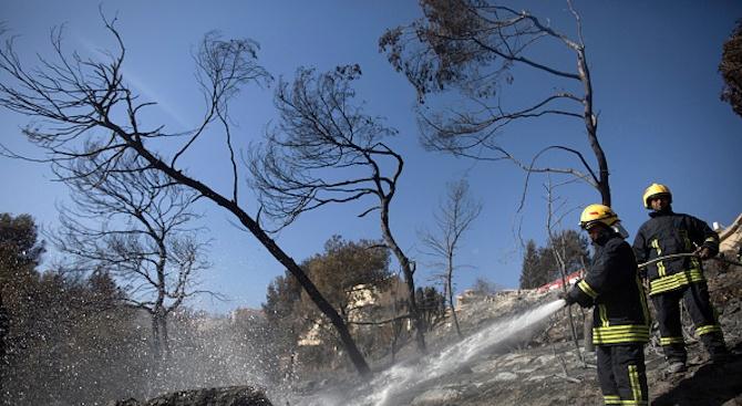 Седмица след опустошителните пожари в района на гръцката столица Атина,