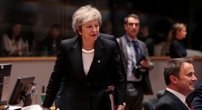Британската министър-председателка Тереза Мей обвини днес бившия премиер лейбърист Тони
