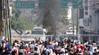 Четири станаха жертвите от сблъсъцитевъв Венецуела