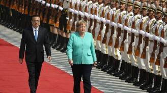 Меркел и Ли Къцян разговаряха за търговските отношения и за Хонконг при срещата си в Пекин