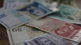 Фирмите у нас вече плащат лихва на банките, за да държат пари на депозит