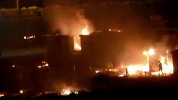 Сблъсъци и пожар в мигрантски лагер във Франция